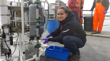 Georgina taking a water sample from the CTD