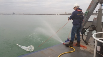 The zooplankton net being drawn back in